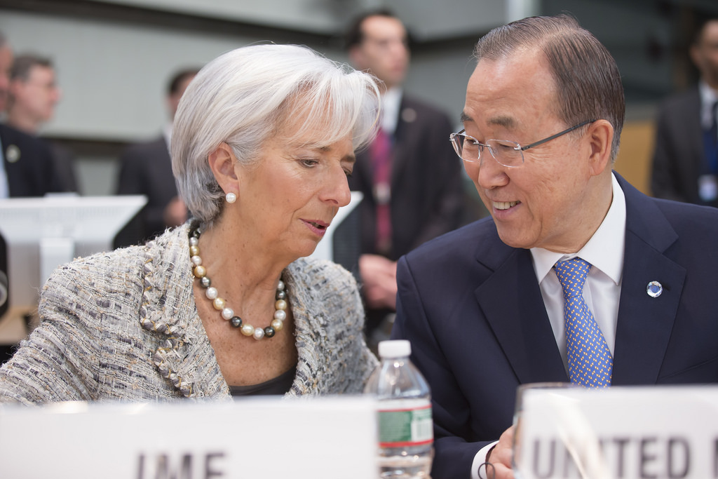 International Monetary Fund Managing Director Christine Lagarde (L) speaks with Secretary-General of the United Nations Ban Ki-moon (R) at the High Level Meeting of the Ebola Recovery April 17, 2015 during the 2015 IMF/World Bank Spring Meetings at World Bank Headquarters in Washington, DC